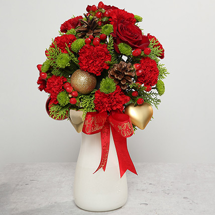 Red Carnations and Roses Arrangement: Christmas Flowers to Sharjah