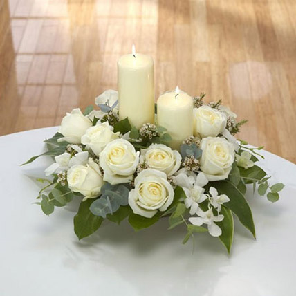 Center Table Arrangement: Funeral Flowers to Abu Dhabi