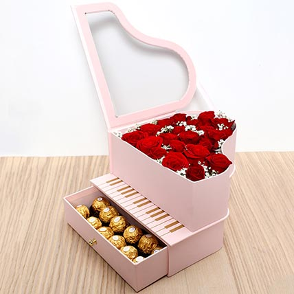 Roses and Chocolates Pink Heart Box: Valentine Day Gift Hampers to Ajman