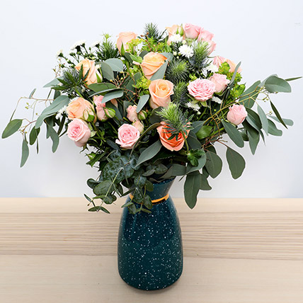 Pastel Coloured  Roses Vase: Womens Day Flowers in Sharjah