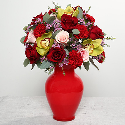 Mixed Flowers In Red Glass Vase