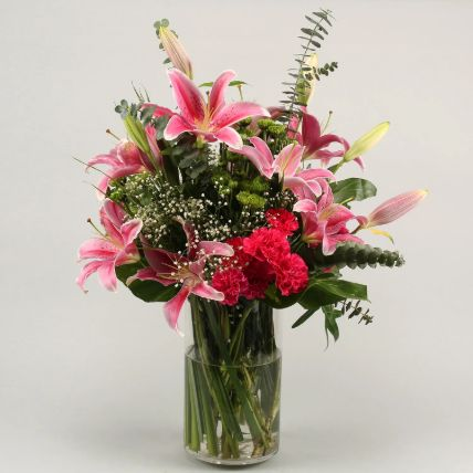 Gorgeous Flowers In Cylinder Vase