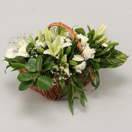 White Lilies & Carnations In Handle Cane Basket