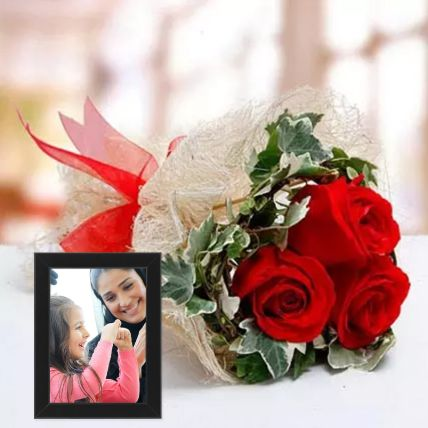 Red Roses Bouquet And Black Photo Frame
