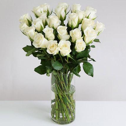 White Roses In Hurricane Vase